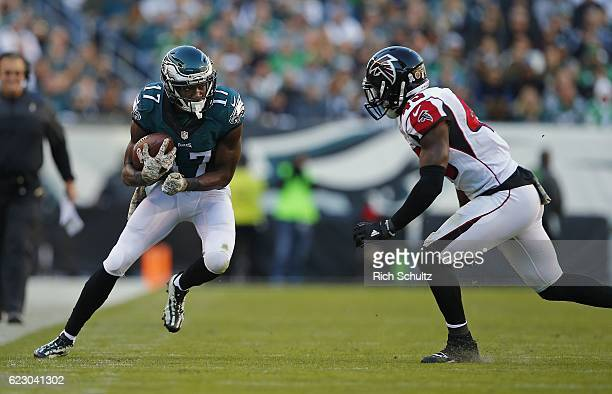 Nelson Agholor of the Philadelphia Eagles runs for additional yards after making a catch as Deion Jones of the Atlanta Falcons closes in during the...