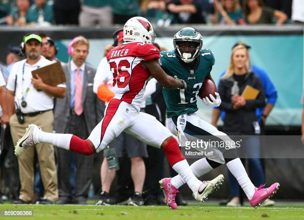 Nelson Agholor of the Philadelphia Eagles runs with the ball and scores a touchdown against Budda Baker of the Arizona Cardinals in the third quarter...