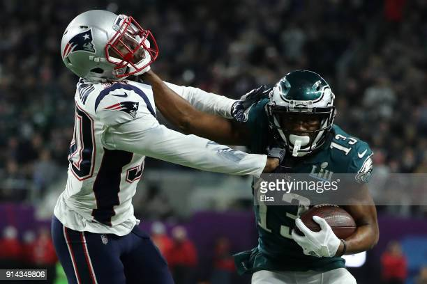 Nelson Agholor of the Philadelphia Eagles stiff arms Duron Harmon of the New England Patriots during the second half in Super Bowl LII at US Bank...