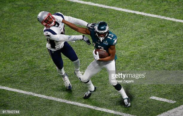 Nelson Agholor of the Philadelphia Eagles stiff arms Duron Harmon of the New England Patriots during a reception for an 18yard gain in Super Bowl LII...