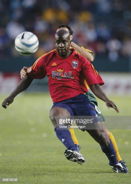 Nelson Akwari of Real Salt Lake holds off the challenge of Landon Donovan of the Los Angeles Galaxy during the first half of their Major League...