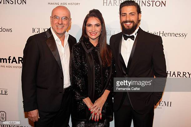 Nelson Alvarenga Adriana Bozon and Caua Reymond attend the 5th Annual amfAR Inspiration Gala at the home of Dinho Diniz on April 10 2015 in Sao Paulo...