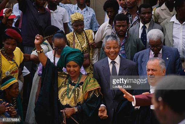 Nelson and Winnie Mandela with their lawyer George Bizos as they enter court for her trial on child kidnapping and assault charges Former President...