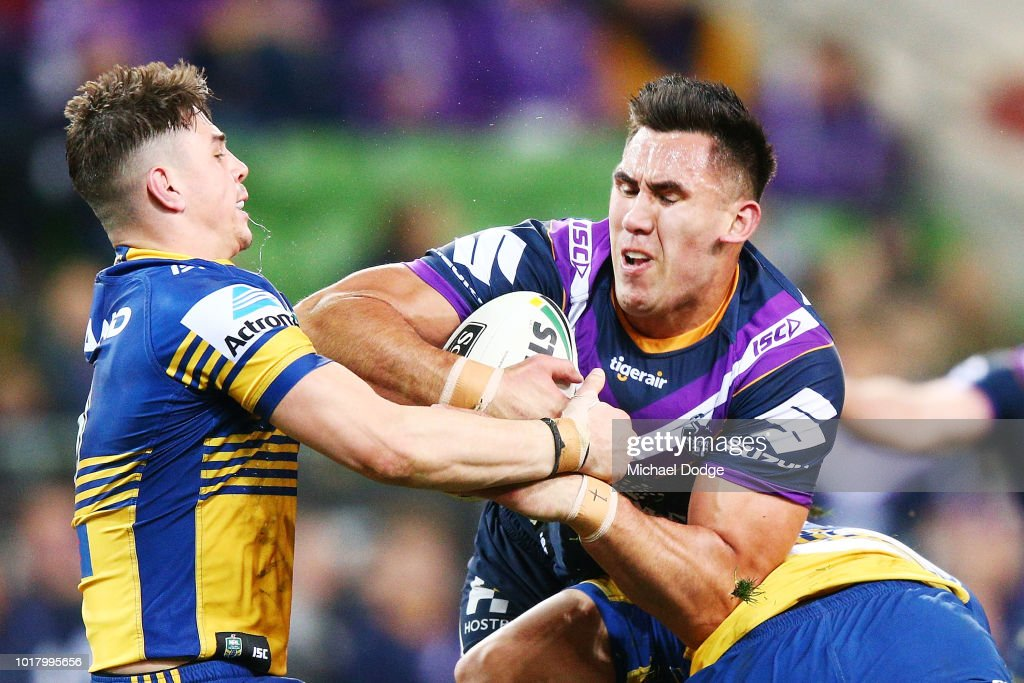 Nelson Asofa Solomona of the Storm runs with the ball through Reed Mahoney of the Eels during the round 23 NRL match between the Melbourne Storm and the Parramatta Eels at AAMI Park on August 17, 2018 in Melbourne, Australia.
