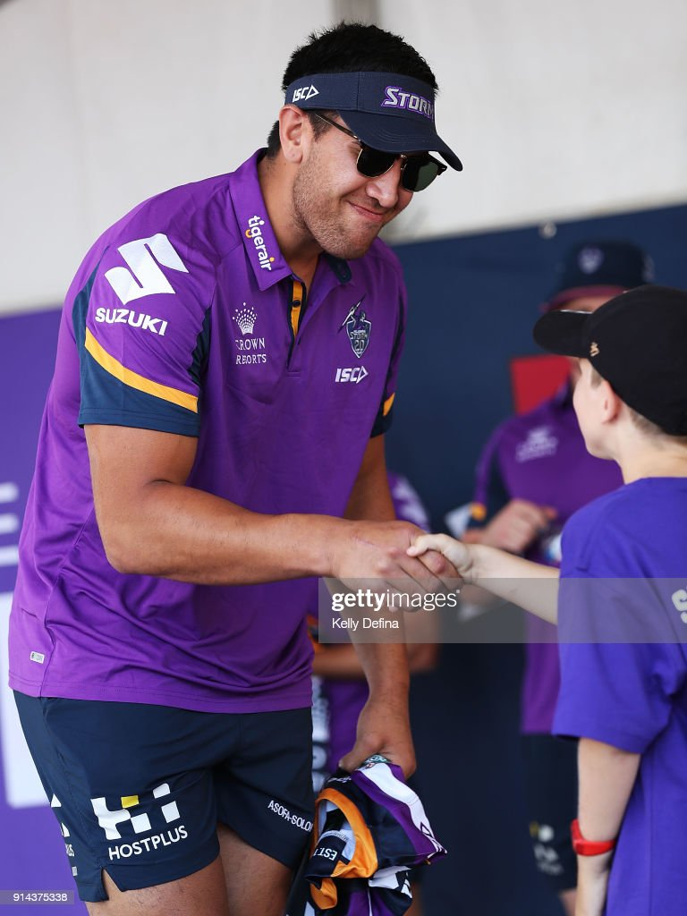 Nelson Asofa-Solomona is presented with his jersey by a young fan during the Melbourne Storm Family Day on February 3, 2018 in Melbourne, Australia.