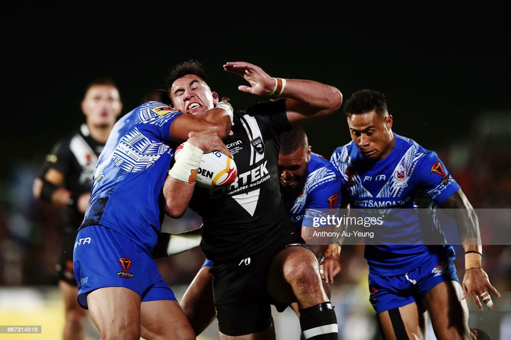 Nelson Asofa-Solomona of the Kiwis is tackled during the 2017 Rugby League World Cup match between the New Zealand Kiwis and Samoa at Mt Smart Stadium on October 28, 2017 in Auckland, New Zealand.