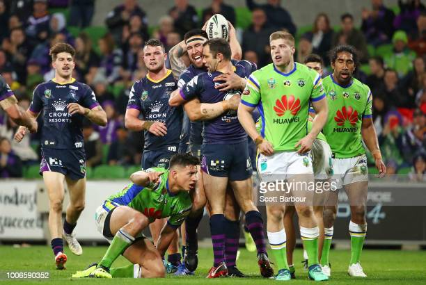 Nelson AsofaSolomona of the Melbourne Storm is congratulated by Cameron Smith of the Melbourne Storm after scoring a try during the round 20 NRL...