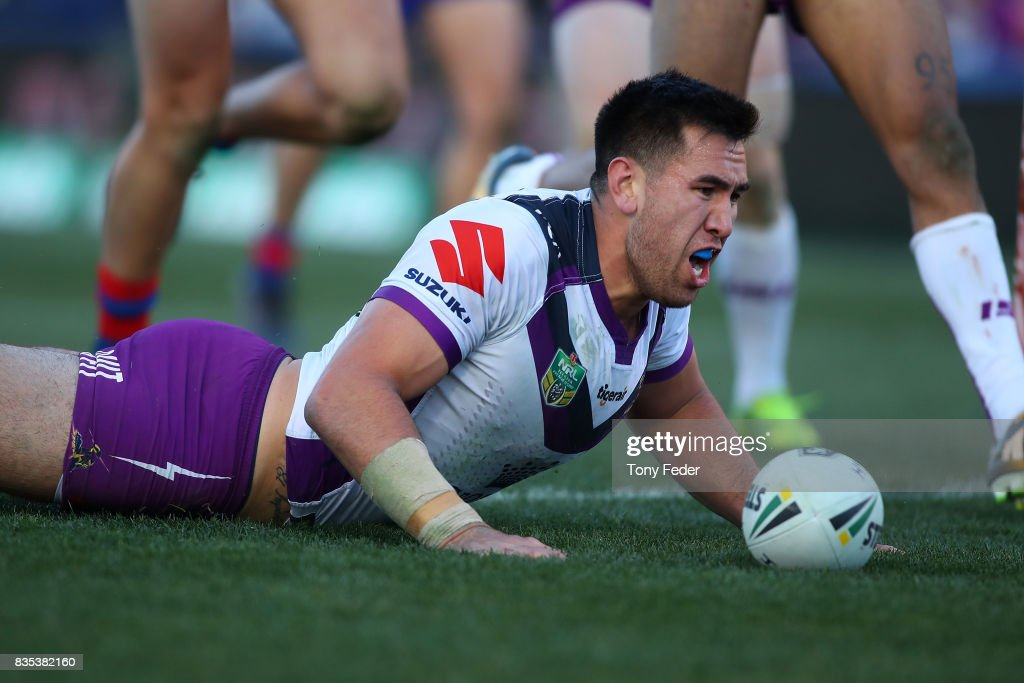 Nelson Asofa-Solomona of the Storm celebrates a try during the round 24 NRL match between the Newcastle Knights and the Melbourne Storm at McDonald Jones Stadium on August 19, 2017 in Newcastle, Australia.