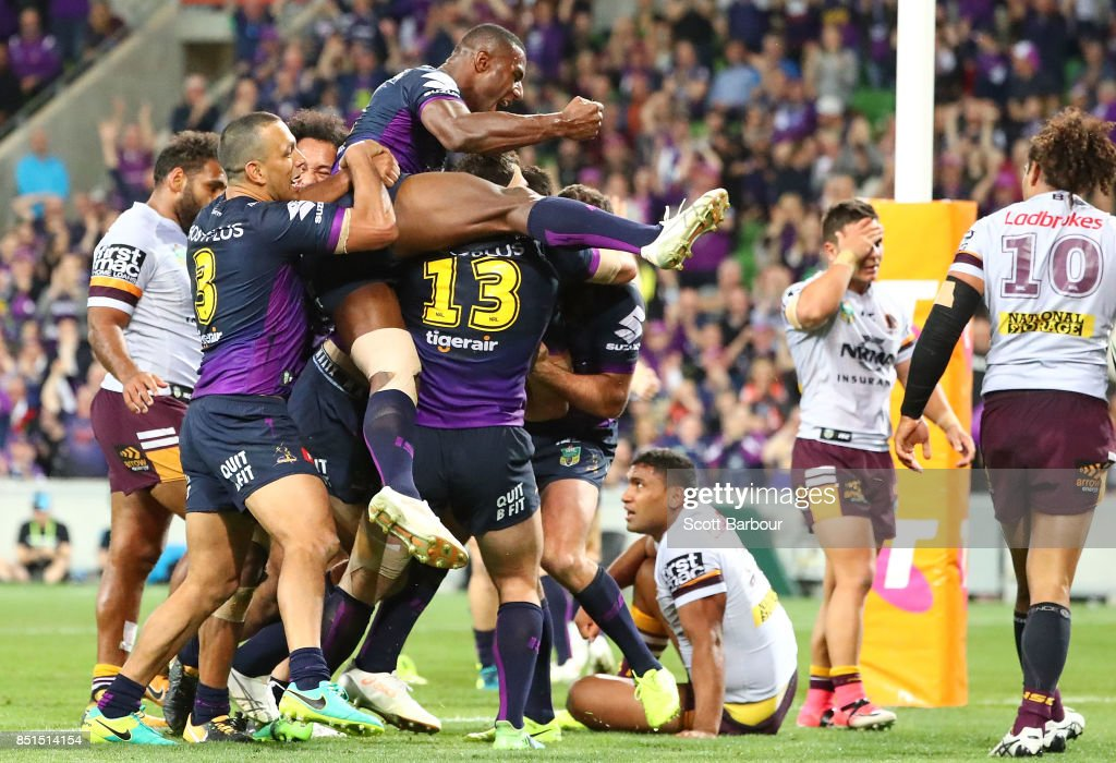 Nelson Asofa-Solomona of the Storm is congratulated by Suliasi Vunivalu and his teammates after scoring a try during the NRL Preliminary Final match between the Melbourne Storm and the Brisbane Broncos at AAMI Park on September 22, 2017 in Melbourne, Australia.
