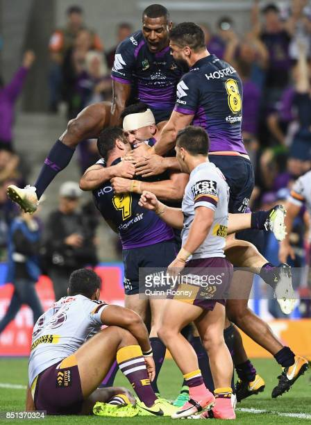 Nelson AsofaSolomona of the Storm is congratulated by team mates after scoring a try during the NRL Preliminary Final match between the Melbourne...