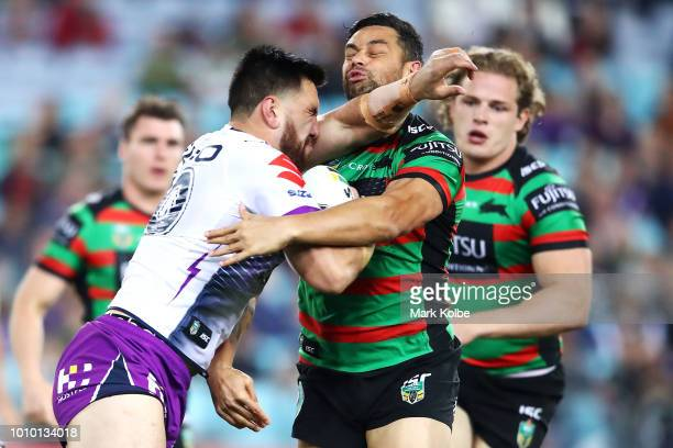 Nelson AsofaSolomona of the Storm is tackled by John Sutton of the Rabbitohs during the round 21 NRL match between the South Sydney Rabbitohs and the...