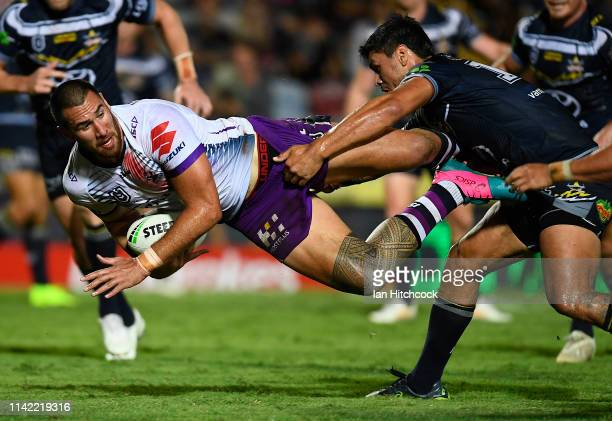 Nelson Asofa-Solomona of the Storm is tackled by Jordan McLean of the Cowboys during the round five NRL match between the North Queensland Cowboys...