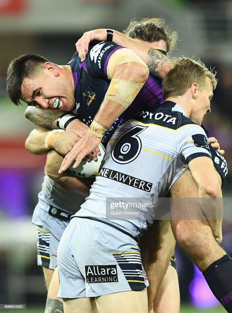Nelson Asofa-Solomona of the Storm is tackled by Kyle Laybutt of the Cowboys during the round 15 NRL match between the Melbourne Storm and the North Queensland Cowbpys at AAMI Park on June 17, 2017 in Melbourne, Australia.