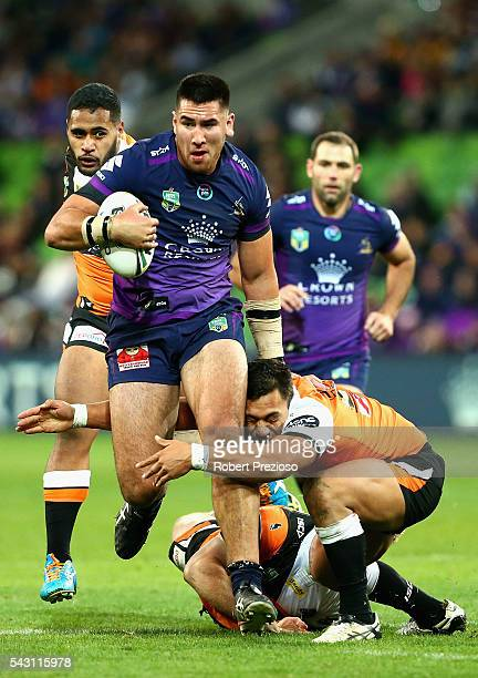 Nelson AsofaSolomona of the Storm is tackled during the round 16 NRL match between the Melbourne Storm and Wests Tigers at AAMI Park on June 26 2016...