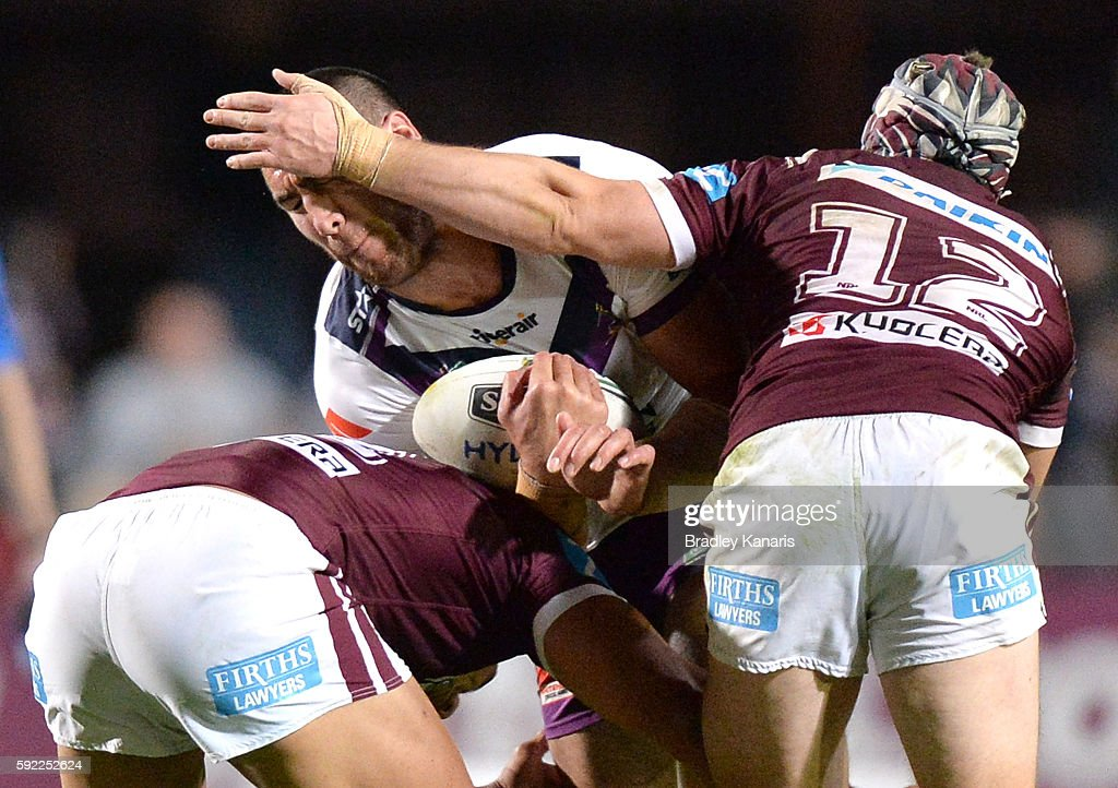 Nelson Asofa-Solomona of the Storm is tackled during the round 24 NRL match between the Manly Sea Eagles and the Melbourne Storm at Brookvale Oval on August 20, 2016 in Sydney, Australia.