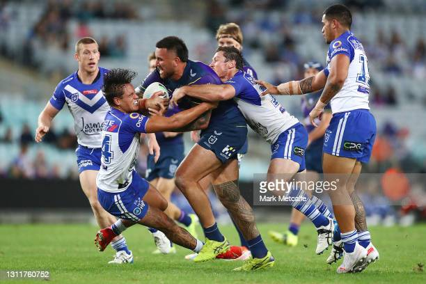Nelson Asofa-Solomona of the Storm is tackled during the round five NRL match between the Canterbury Bulldogs and the Melbourne Storm at Stadium...