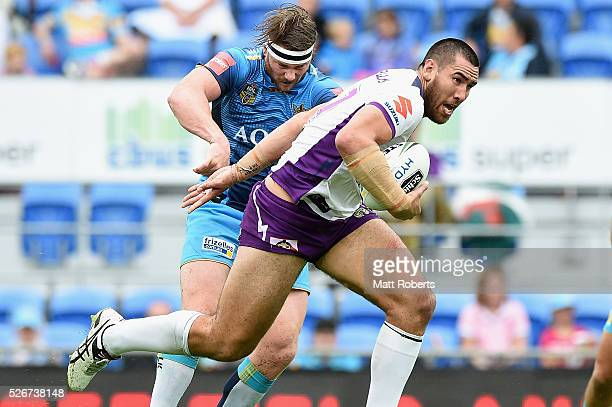 Nelson AsofaSolomona of the Storm makes a break during the round nine NRL match between the Gold Coast Titans and the Melbourne Storm on May 1 2016...