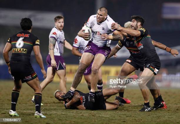 Nelson Asofa-Solomona of the Storm makes a break over Apisai Koroisau of the Panthers during the round six NRL match between the Penrith Panthers and...
