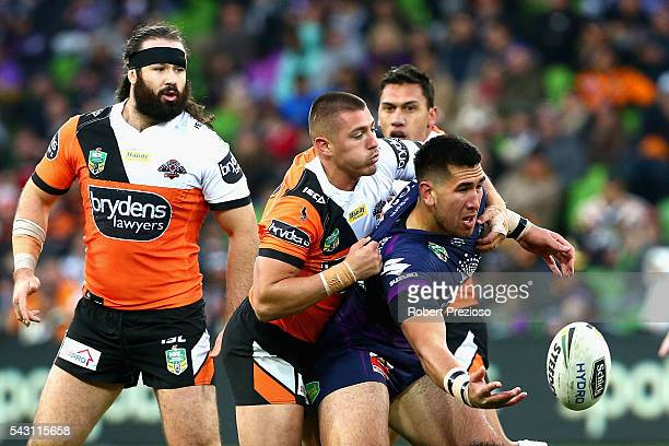 Nelson AsofaSolomona of the Storm offloads during the round 16 NRL match between the Melbourne Storm and Wests Tigers at AAMI Park on June 26 2016 in...