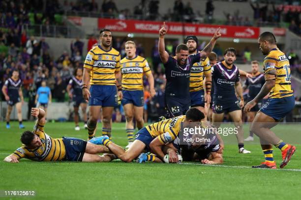 Nelson Asofa-Solomona of the Storm scores a try during the NRL Semi Final match between the Melbourne Storm and the Parramatta Eels at AAMI Park on...