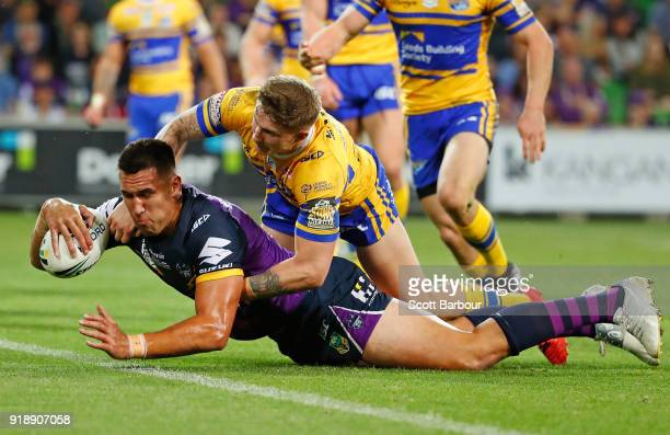 Nelson AsofaSolomona of the Storm scores a try during the World Club Challenge match between the Melbourne Storm and the Leeds Rhinos at AAMI Park on...