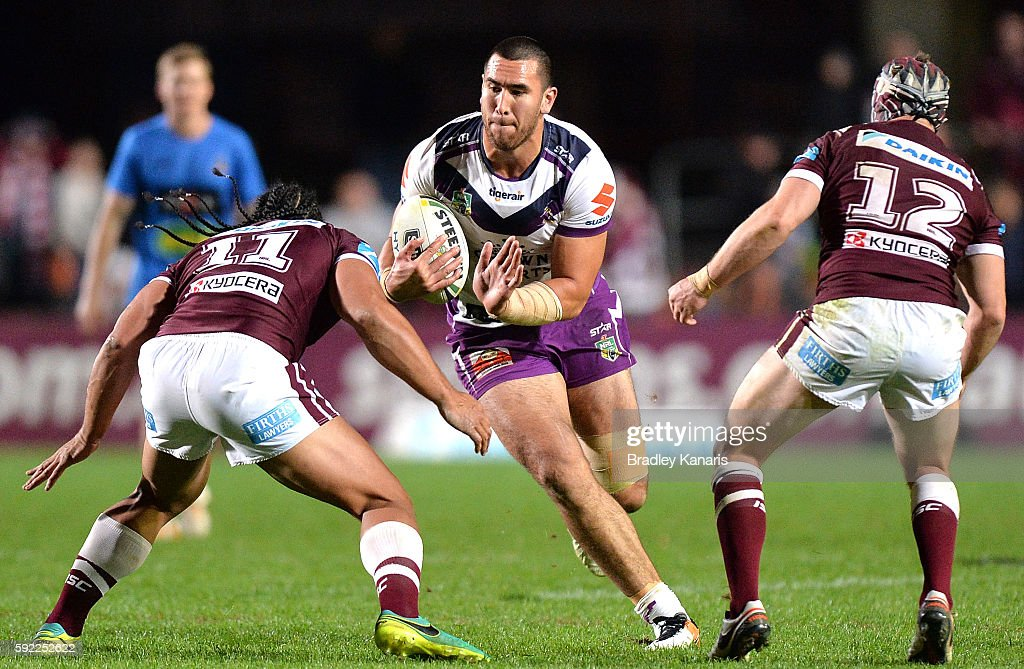 Nelson Asofa-Solomona of the Storm takes on the defence during the round 24 NRL match between the Manly Sea Eagles and the Melbourne Storm at Brookvale Oval on August 20, 2016 in Sydney, Australia.