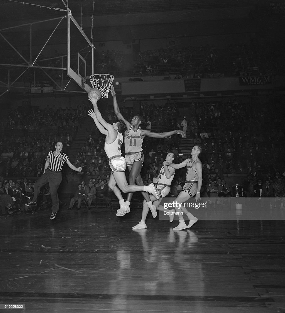 Nelson Bobb attempts to make a basket while Earl Lloyd reaches for the block during a game at Madison Square Garden in 1953. Just three years earlier, Earl Lloyd became the first African American to play in the NBA.