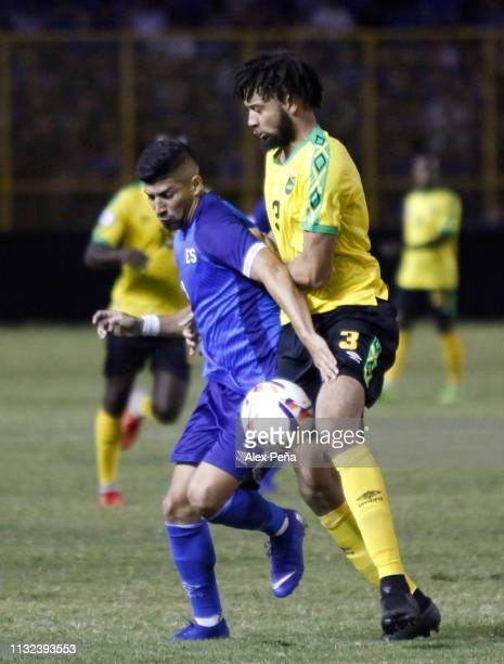 Nelson Bonilla of El Salvador battles for the ball with Michael Hector # of Jamaica during a match between El Salvador and Jamiaca as part of the...
