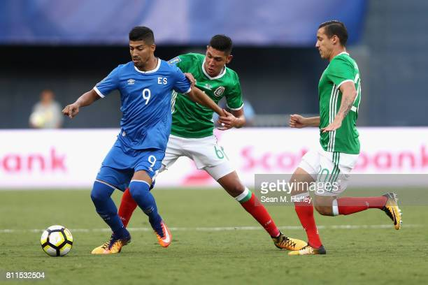 Nelson Bonilla of El Salvador dribbles past Edson Alvarez and Jesus Duenas of Mexico during the first half of a 2017 CONCACAF Gold Cup Group C match...