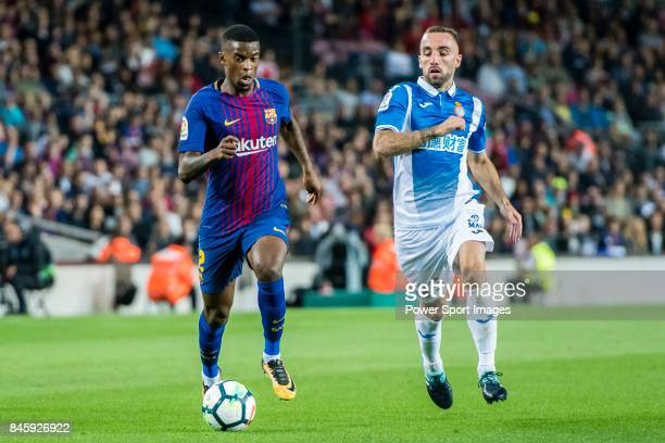 Nelson Cabral Semedo of FC Barcelona fights for the ball with Sergi Darder Moll of RCD Espanyol during the La Liga match between FC Barcelona vs RCD...