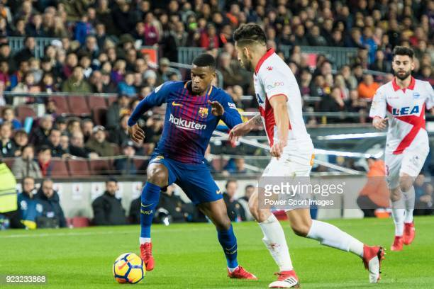 Nelson Cabral Semedo of FC Barcelona is tackled by Guillermo Alfonso Maripan of Deportivo Alaves during the La Liga 201718 match between FC Barcelona...
