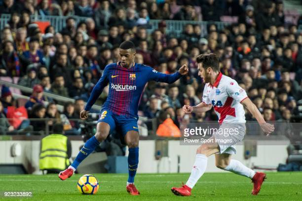 Nelson Cabral Semedo of FC Barcelona is tackled by Ibai Gomez Perez of Deportivo Alaves during the La Liga 201718 match between FC Barcelona and...
