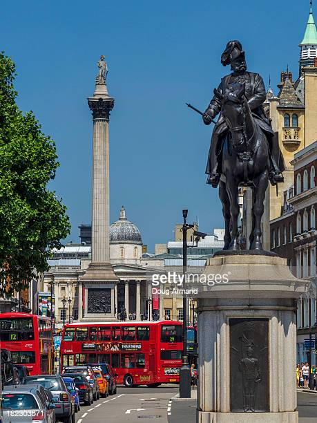 nelson column and trafalgar sqaure, london - whitehall london stock photos and pictures