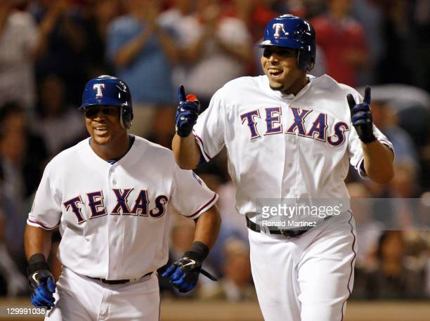 Nelson Cruz and Adrian Beltre of the Texas Rangers celebrate after Cruz hits a tworun home run in the fourth inning during Game Three of the MLB...