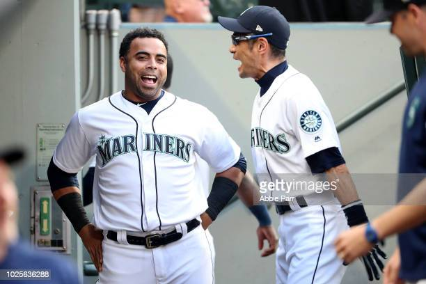 Nelson Cruz and Ichiro Suzuki of the Seattle Mariners have a conversation in the dugout prior to taking on the Los Angeles Dodgers during their game...