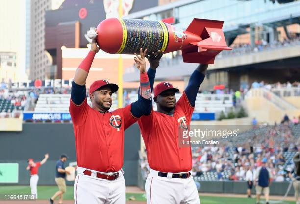 Nelson Cruz and Miguel Sano of the Minnesota Twins are presented an award by the Minneapolis bomb squad for the setting the MLB single season home...