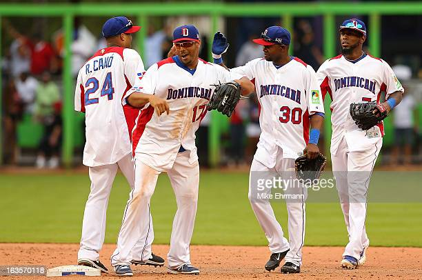 Nelson Cruz and Robinson Cano of the Dominican Republic celebrate after winning a World Baseball Classic second round game against Italy at Marlins...