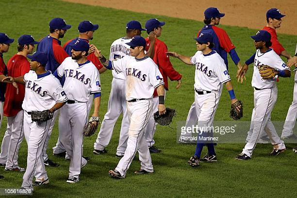 Nelson Cruz Jeff Francoeur Josh Hamilton Ian Kinsler and Elvis Andrus of the Texas Rangers celebrate with their teammates after they won 72 against...