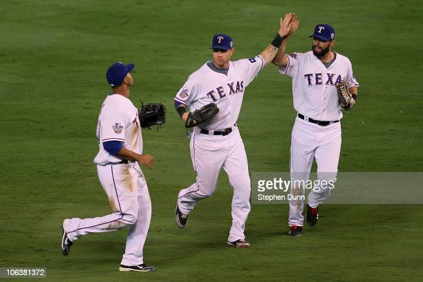 Nelson Cruz Josh Hamilton and Jeff Francoeur of the Texas Rangers celebrate after their 42 win against the San Francisco Giants in Game Three of the...