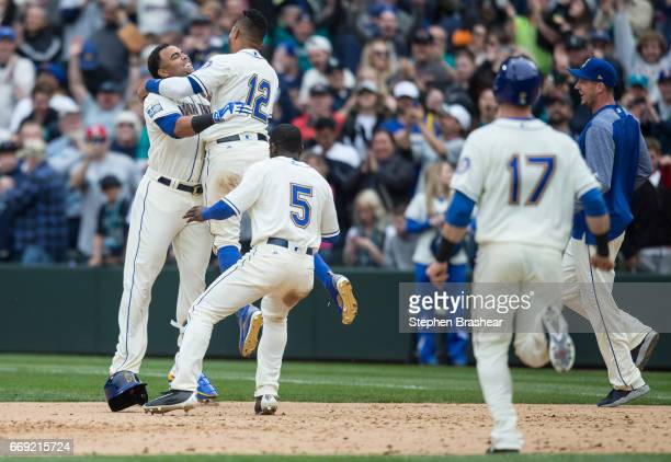 Nelson Cruz Leonys Martin Guillermo Heredia and Mitch Haniger of the Seattle Mariners celebrate a victory over the Texas Rangers after Cruz hit a...