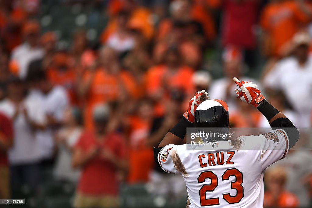 Nelson Cruz #23 of the Baltimore Orioles celebrates a home run in the ninth inning against the Minnesota Twins at Oriole Park at Camden Yards on September 1, 2014 in Baltimore, Maryland. The Minnesota Twins won, 6-4.