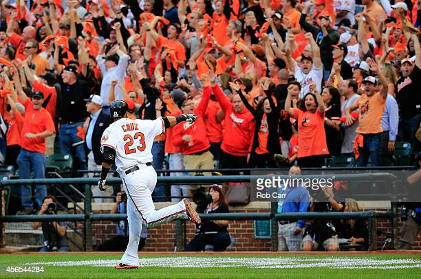 Nelson Cruz of the Baltimore Orioles celebrates after hitting a two run home run to right center field against Max Scherzer of the Detroit Tigers in...