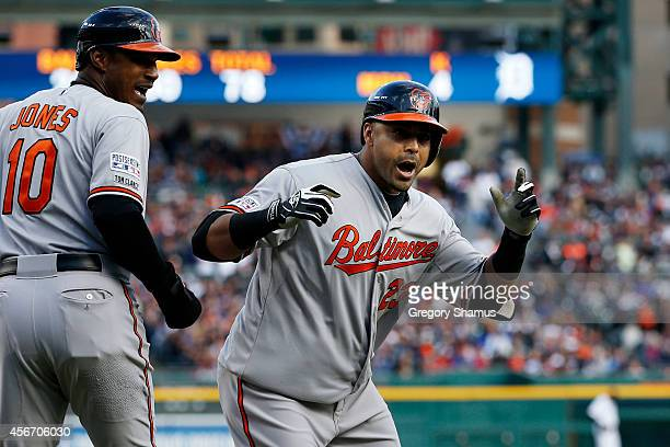 Nelson Cruz of the Baltimore Orioles celebrates with Adam Jones after hitting a tworun home run in the sixth inning against the Detroit Tigers during...