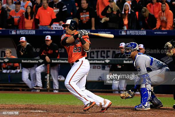 Nelson Cruz of the Baltimore Orioles grounds into fielder's choice to Alcides Escobar of the Kansas City Royals scoring Alejandro De Aza of the...