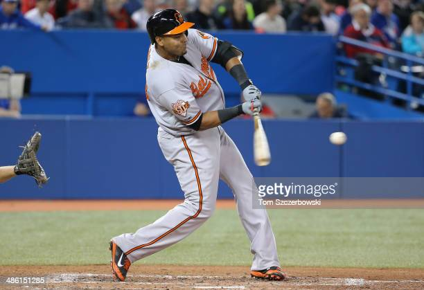 Nelson Cruz of the Baltimore Orioles hits a threerun home run in the sixth inning during MLB game action against the Toronto Blue Jays on April 22...