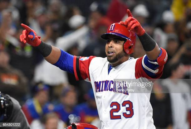 Nelson Cruz of the Dominican Republic celebrates after hitting a solo home run during the eighth inning of the World Baseball Classic Pool F Game...