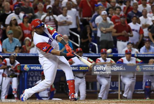 Nelson Cruz of the Dominican Republic hits a three run home run during the eighth inning of a Pool C game of the 2017 World Baseball Classic against...