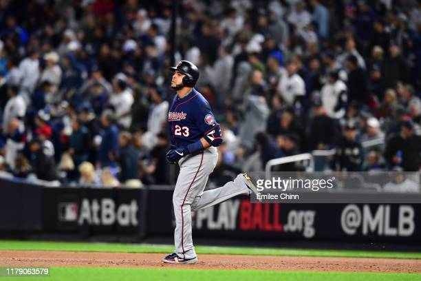 Nelson Cruz of the Minnesota Twins celebrates after hitting a solo home run against James Paxton of the New York Yankees during the third inning in...