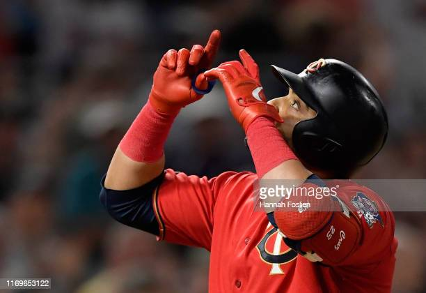 Nelson Cruz of the Minnesota Twins celebrates after hitting a tworun home run against the Kansas City Royals during the seventh inning of the game at...