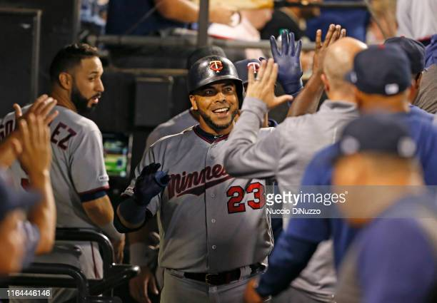 Nelson Cruz of the Minnesota Twins celebrates following his solo home run during the seventh inning of a game against the Chicago White Sox at...